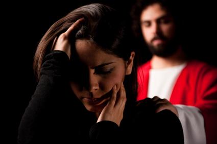 christ behinde grieving girl